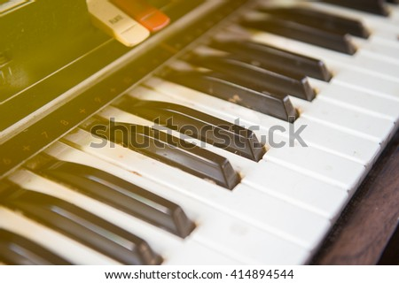 The old piano with sunlight. - stock photo