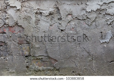 The old plaster on the brick wall