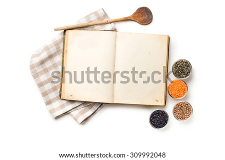 the old recipe book and lentils legumes - stock photo