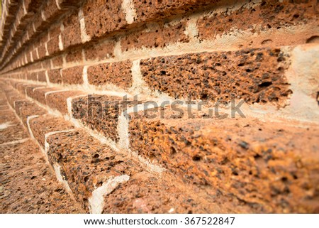 The old red brick wall in the public temple in Thailand