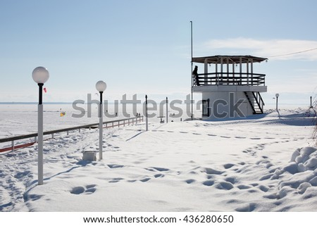 the old rescue station. winter seascape. - stock photo