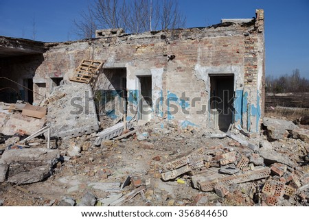 The old ruined brick building. Piles of construction debris. - stock photo