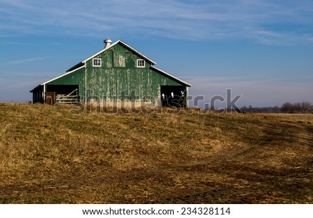 The old rural barn on the hill. - stock photo