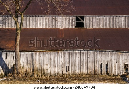 The old rural horse stable in the Midwest. - stock photo