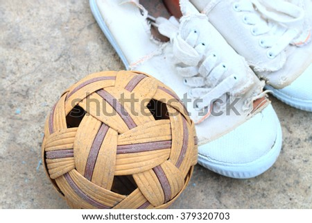 The old Sepak Takraw ball and shoes for play