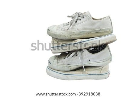 The old shoe tower.dirty sneakers isolated on white. This has clipping path. copy space.  - stock photo
