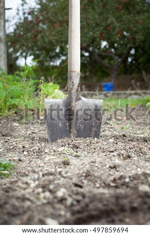 The old spade in the filed of soil