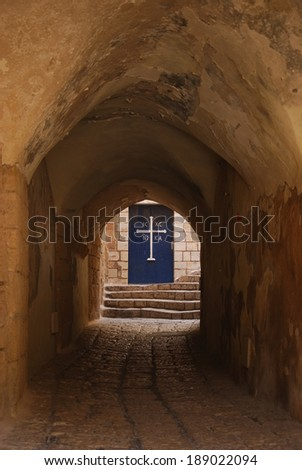 The old streets of Jaffa, gate to the monastery - stock photo