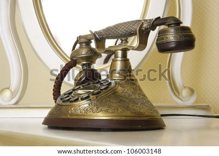 The old telephone with disc dials - stock photo