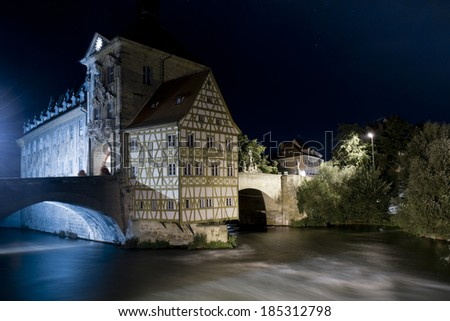 The old town hall situated on the river Regnitz, in the medieval center of Bamberg, in Bavaria, Germany. An Unesco world heritage site - stock photo