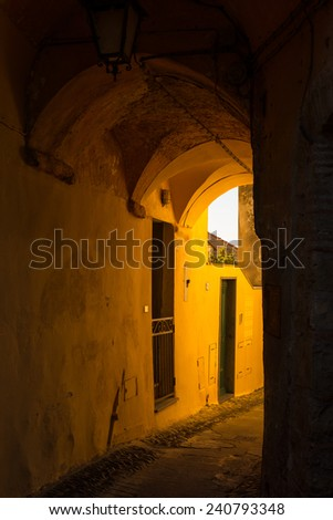 The old town of Cervo, Liguria, Italy, with its narrow colorful alleys. - stock photo