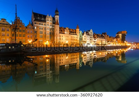The old town of Gdansk at Motlawa river with pirate ship, Poland - stock photo