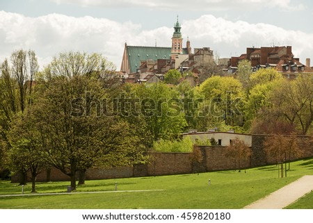 The old town of Warsaw as seen from a park next to Vistula river