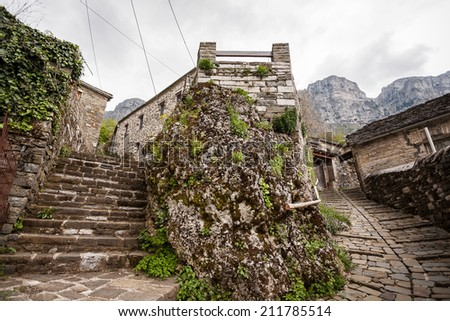 The old traditional stone houses in Zagoria, Greek village, Greece, near Ioannina city, Epirus, during a cloudy spring day.