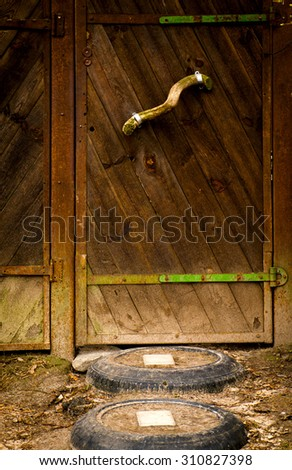 The old vintage wooden door, brown colour - stock photo