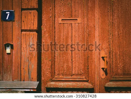 The old vintage wooden doors, red colour - stock photo
