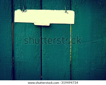 The old vintage wooden fence with metal sign, green colour - stock photo