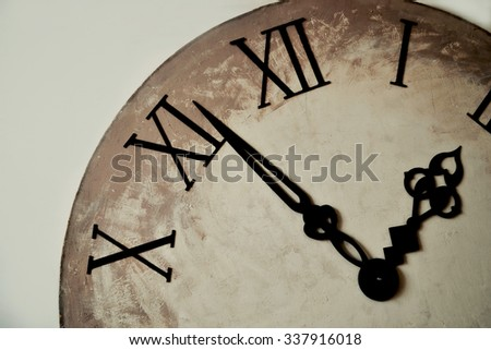 The old wall antikvariarnye hour with Roman numerals. - stock photo