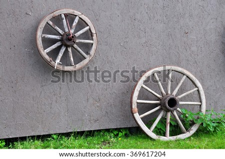 The old wheel is used to create the interior. Horse stable - stock photo