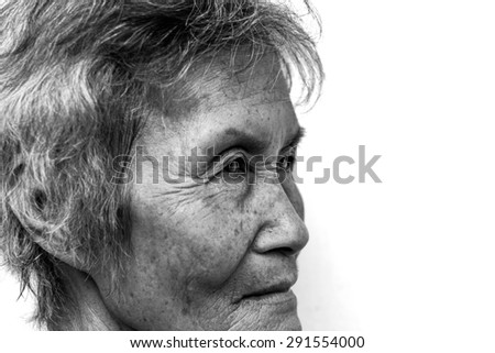 The old woman 's face, black and white image. - stock photo