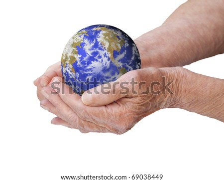The old woman's hands holding earth - stock photo