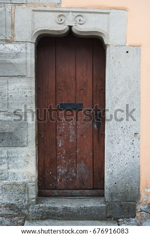 The Old Wood Door On Classic Old Wall In Europe