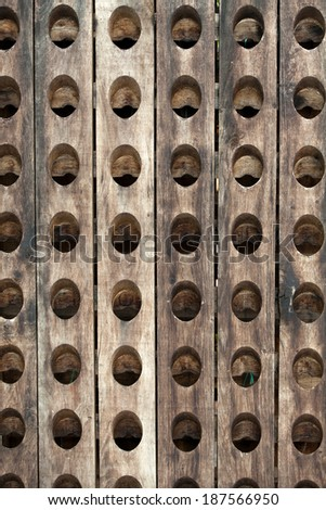 the old wooden bottle rack - stock photo