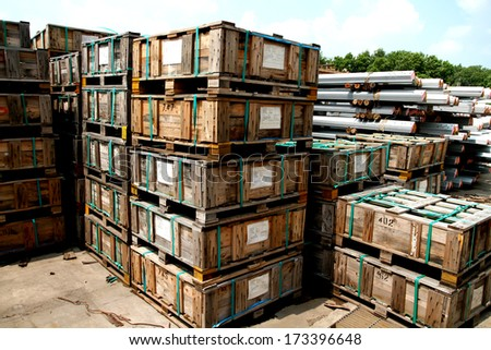 The old wooden pallet bunch in outdoor warehouse - stock photo