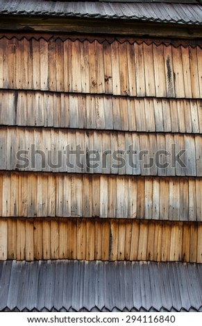 The old wooden shingle surface. Close up. - stock photo