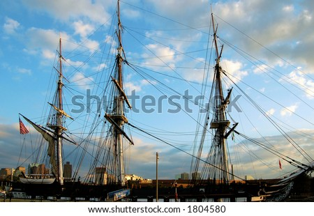 The oldest commissioned ship in the Navy stands guard at Boston Harbor. - stock photo