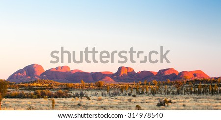 The Olgas at sunrise on a clear winter's morning in the Northern Territory, Australia - stock photo