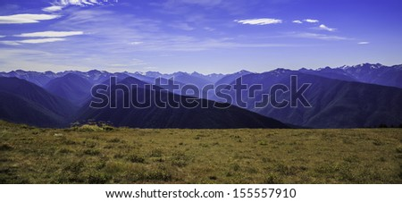 The Olympic Mountains as seen from the Hurricane Ridge visitor�s center under blue skies. - stock photo
