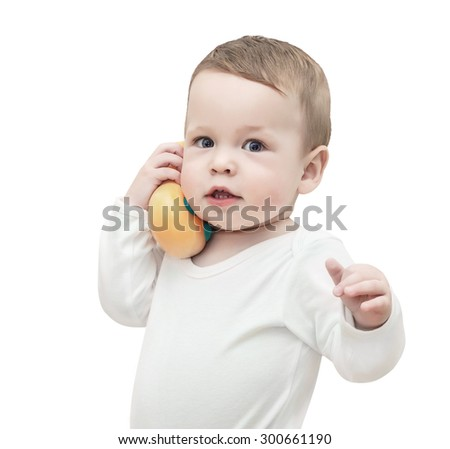 The one-year-old kid speaks by phone,  isolated on the white - stock photo