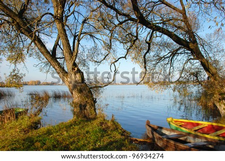 The only one boat resting place is on the coast of the lake. - stock photo