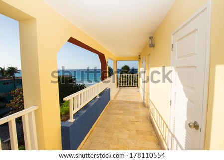 The open corridor hotel with ocean views - stock photo