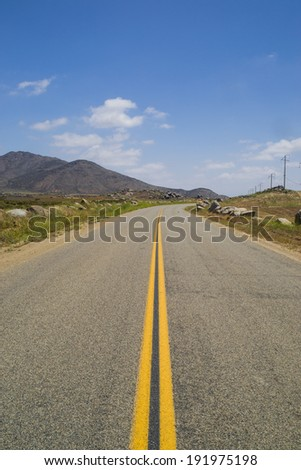 The open road through the Southern California desert.