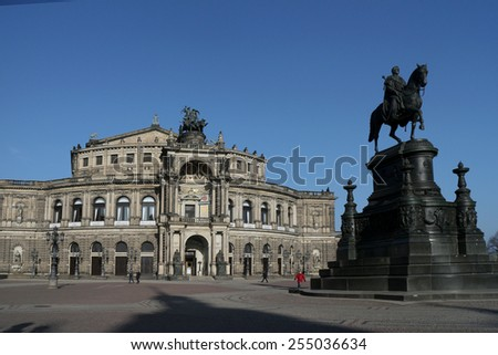 The Opera House Semperoper with the Monument Johann Koenig statue on the Theatre Square in Dresden. - stock photo