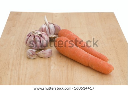 The  orange carrot  and garlic isolated on white