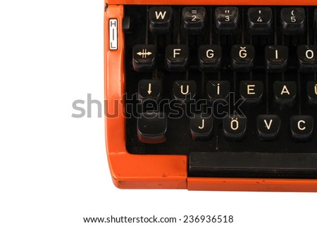 The Orange Vintage Typewriter on the White Background - stock photo