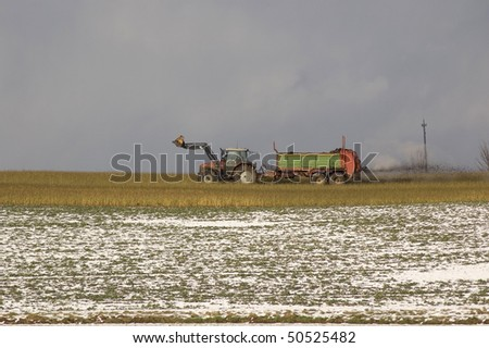 The organic fertilizers on the snow-covered field.