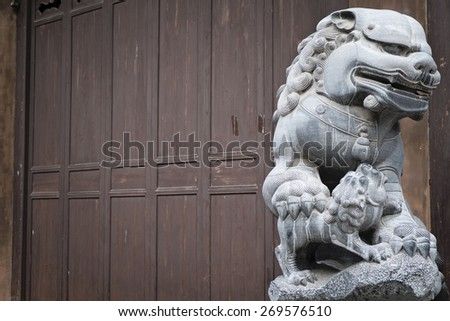 The oriental stone lion - the guardian - stock photo