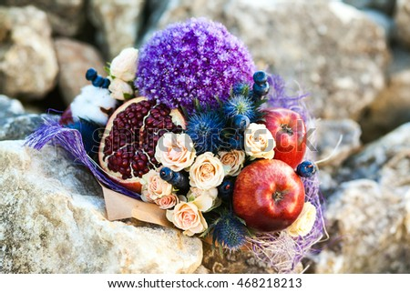The original unusual edible bouquet of fruits on a stones