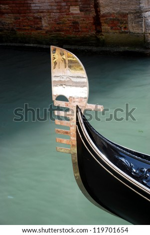 The ornaments on the front (Prow - Ferro) of the Gondola represent symbols of Venice. - stock photo