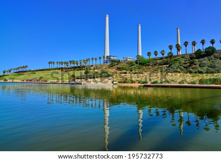 The Orot Rabin (formerly Maor David) power plant in Hadera, Israel with the Hadera Stream Water Park in the foreground - super wide angle view