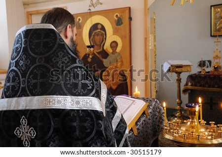 The orthodox priest serves in church of a female monastery - stock photo