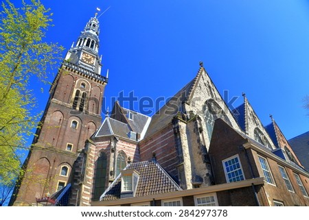 The Oude Kerk (Old Church) in the old city center of Amsterdam, the Netherlands - stock photo