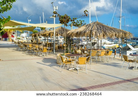 The outdoor restaurant in the traditional Cypriot village of Latchi, that is renowned across Cyprus for it's fresh fish and excellent fish restaurants. - stock photo