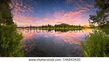 The Oxbow Bend of the Snake River in Wyoming at sunrise - stock photo