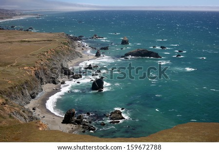 The Pacific Ocean coastline turns rocky and dramatic in California's Sonoma County. - stock photo
