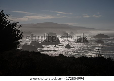 The Pacific Ocean continually batters the rugged northern California coastline in Mendocino. Highway 1 runs right along the coast and provides gorgeous views of the shore and ocean. - stock photo